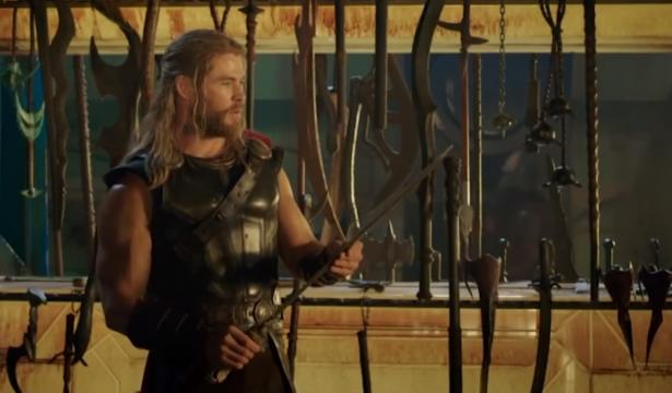 Chris Hemsworth playing with props on the set of 'Thor'. [Image via Looper/YouTube screencap]