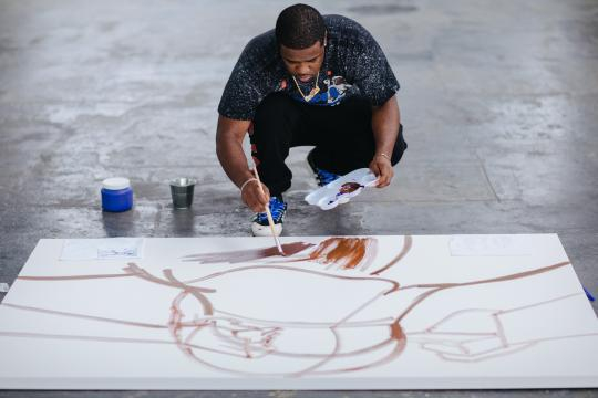 ASAP Ferg creating a painting for Hennessy (image use with permission of Hennessy)