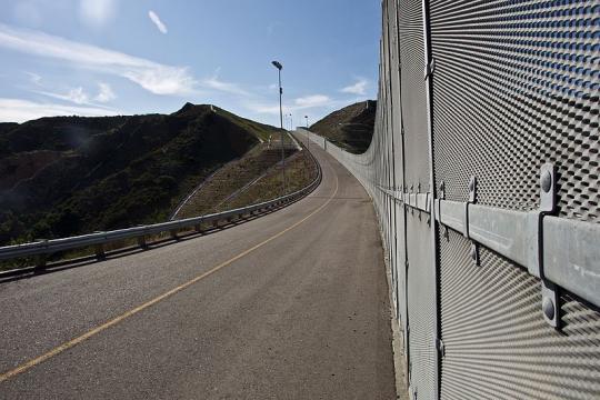 Border Fence near San Diego (Image credit - Josh Denmark, Wikimedia Commons)