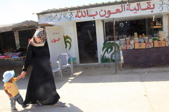The main street of Zaatari refugee camp (Image credit - Russell Watkins, Wikimedia Commons)