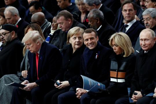 In solemn Paris ceremony, Macron leads global WW1 Armistice ... - reuters.com