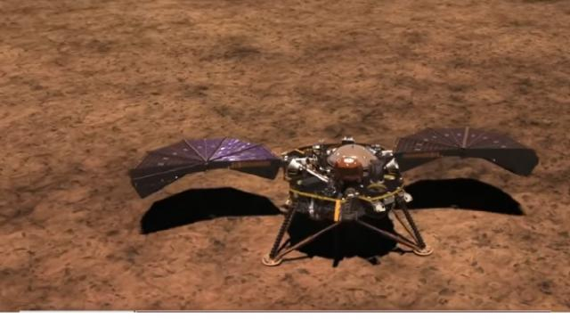 NASA's Insight lander touches down on Mars. [Image source/CBS Evening News YouTube video]