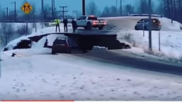 Powerful earthquakes buckle Alaska roads, briefly trigger tsunami warning. [Image source/CBC News: The National YouTube video]