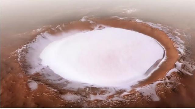 Stunning video shows the ice crater on Mars. [Image source/modern fashion YouTube video]