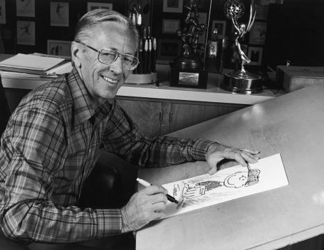 Charles M. Schulz posa mientras dibuja a su personaje Charles Brown