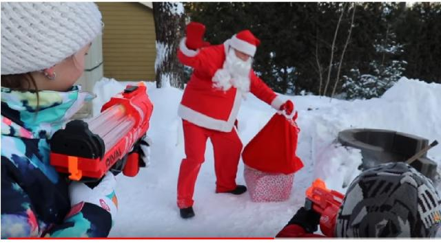 Santa Claus with a sack of gifts. [Image source/Laliberte Cinemas YouTube video]