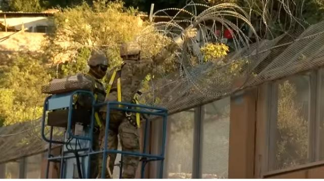U.S. Troops install concertina wire on the Nogales border. [Image source/KGUN9 YouTube video]