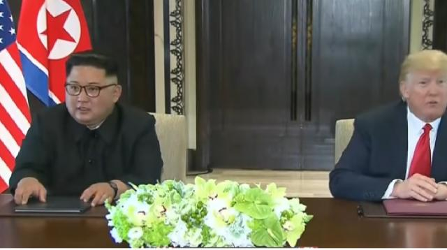 North Korea summit: Trump and Kim Jong Un sign historic agreement. [Image source/CBS This Morning YouTube video]