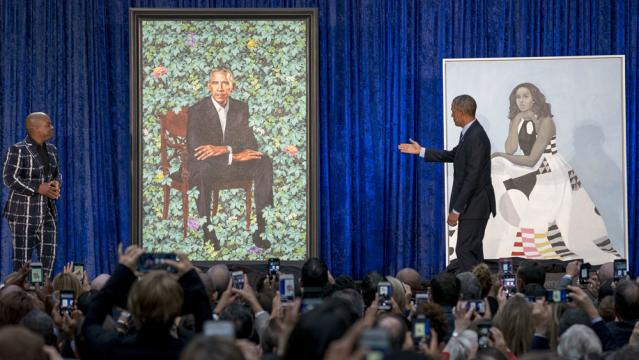 Barack Obama is portrayed against a natural background - By Kehinde Wiley - National Portrait Gallery, via Wikipedia