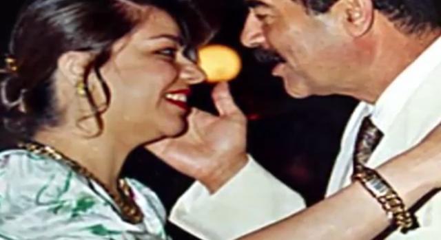 Saddam with his daughter. Image credit Bangladesh TV-Youtube.com
