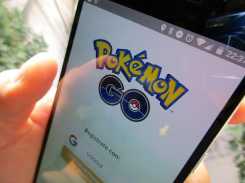 'Pokemon Go' Person Holding Phone With App. - [Image Via flickr /edowoo]