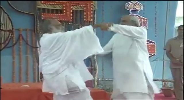 Ex-BJP PM dancing with Baba Asaram. (image Credit: Vipulgarg/ youtube.com)
