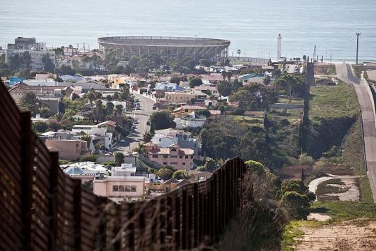 Border Fence with Tijuana on the left ((mage credit - Josh Denmark, Wikimedia Commons)