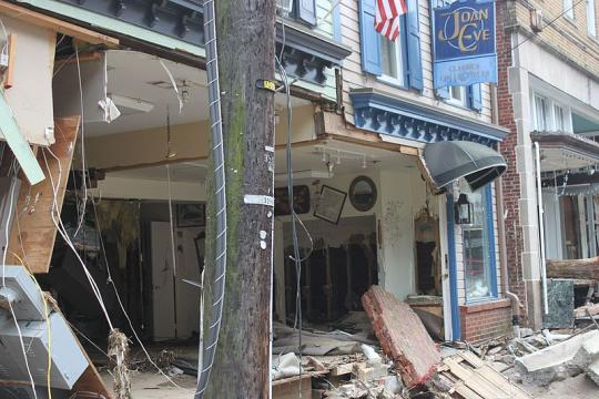 Buildings damaged on Main Street in Old Ellicott City (Image credit – Preservation Maryland, Wikimedia Commons)