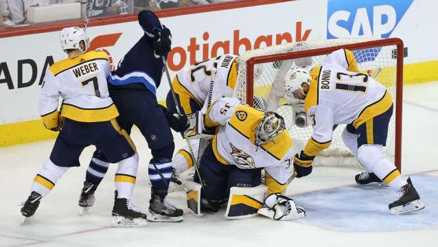 Rinne y la defensa de los Preds, venció a los Jets en Winnipeg. NHL.com.