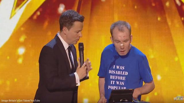Lee Ridley, the Lost Voice Guy types his excitement about his win on his iPad. [Image Britain's Got Talent/YouTube]