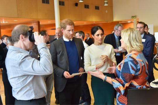 Prince Harry and Ms. Markle on a visit to Catalyst Inc. (Image courtesy – Northern Ireland Office, Wikimedia Commons)