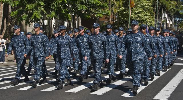 US Navy sailors march on Kalakaua Ave. during a military parade (Image courtesy - Mark Logico, Wikimedia Commons)