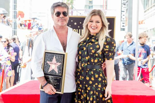 Kelly Clarkson Honors Simon Cowell as He Gets His Hollywood Star ... - (Image via standard.co.uk/Twitter)