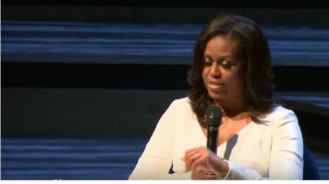 Michelle Obama Launches Memoir In London. [Image source/Shemaroo Holly Bites YouTube video]