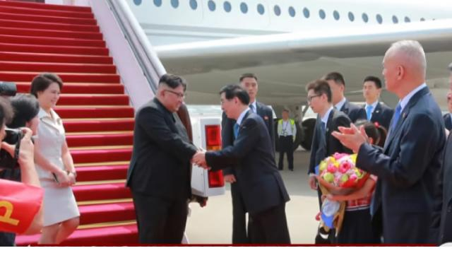 Kim Jong Un meets with China's Xi Jinping for third time. [Image source/CBS News YouTube video]