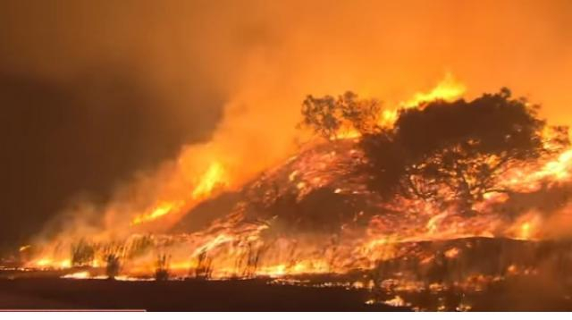 Over 100,000 evacuated in California wildfire. [Image source/CBS Evening News YouTube video]