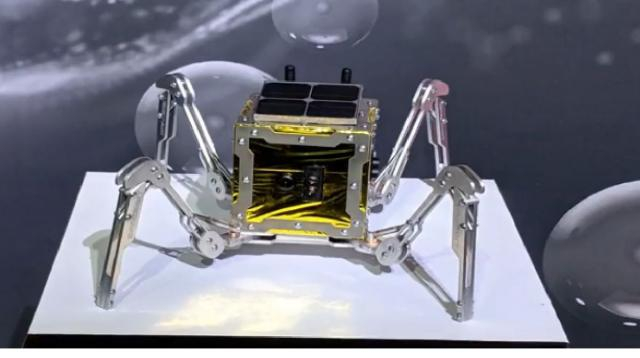 UK unveils tiny walking rover that will explore the moon. [Image source/Daily News Today YouTube video]