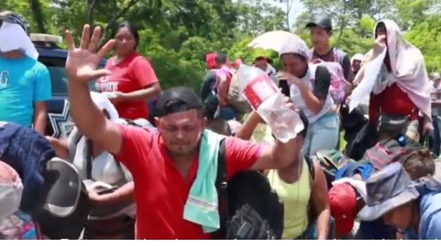 Mexico blocks new caravan of Central American migrants. [Image source/AFP news agency YouTube video]