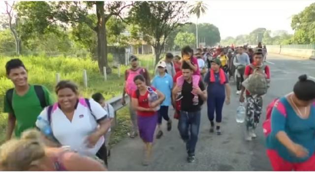 Migrant caravan with mostly women, children begins trek to U.S. border. [Image source/Global News YouTube video]