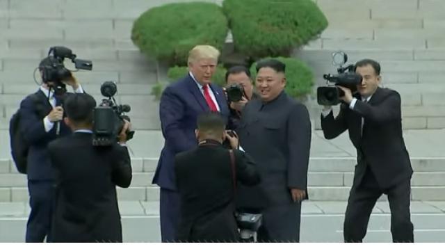 Trump meets Kim Jong Un at Korean DMZ. [Image source/ABC News YouTube video]