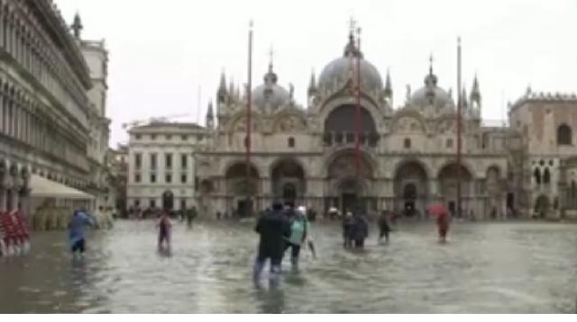 St. Mark's square becomes a lake as flood season begins in Venice. [Image source/No Comment TV YouTube video]