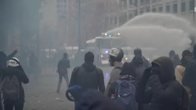 Gilets jaunes: protesters clash with riot police on one-year anniversary of movement. [Image source/Guardian News YouTube video]