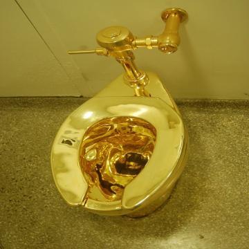Golden Toilet by Cattelan [Image source: Wikpedia Commons J. Pijarowski]