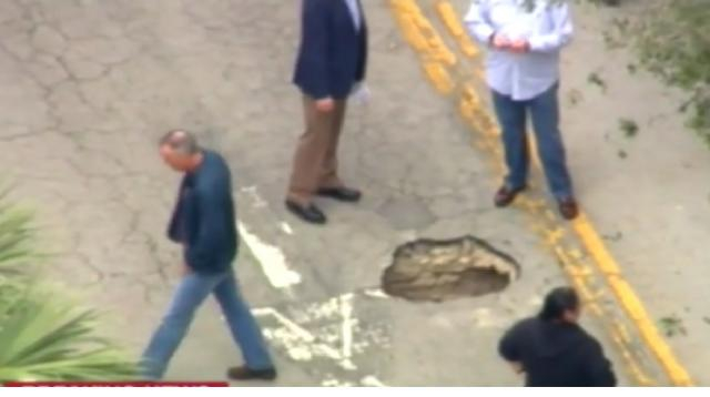Florida sinkhole reveals someone tunneling into Bank! [Image source/wwwMOXNEWSCOM YouTube video]