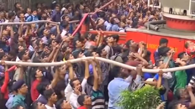 Bangladesh fire: At least 19 dead, rescue underway. [Image source/CGTN YouTube video]