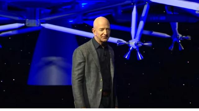 Jeff Bezos unveils Blue Origin's new 'Blue Moon' lunar lander. [Image source/NBC News YouTube video]