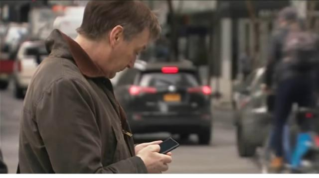 Dangers of texting and walking. [Image Source/RT America YouTube video]