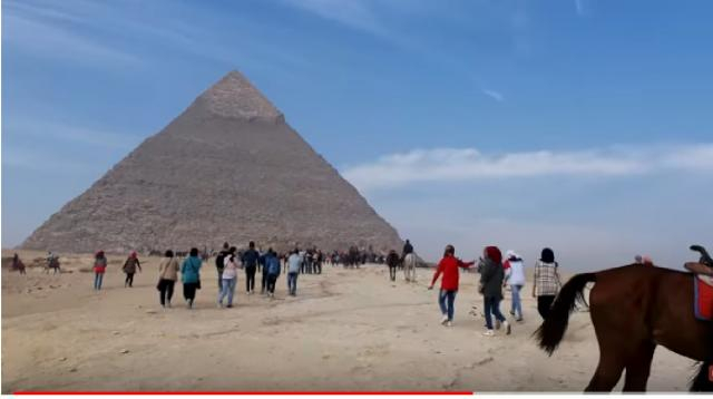 Tourists visit in Great Pyramid of Giza, in Egypt. [Charles Huang/YouTube/Screencap]