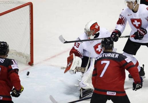 Canadá pudo empatar el juego a 4 centésimas del final del 3er periodo. IIHF.com.
