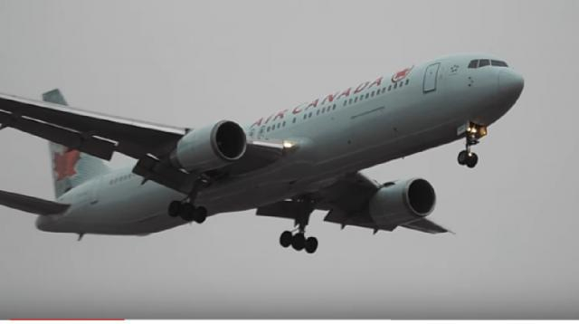 Air Canada Boeing 767-300 misty arrival & departure at Quebec City. [Image source:YQBspotting/YouTube]