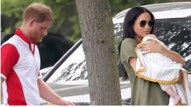 Meghan Markle cradles Archie during surprise appearance at a Charity Polo Match. [Image source/Entertainment Tonight YouTube video]