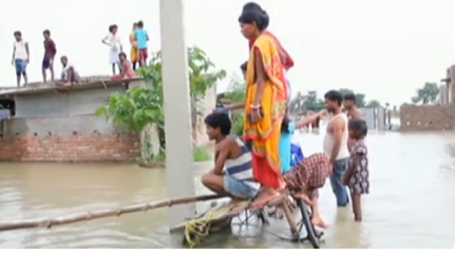 Deadly monsoon flooding in South Asia. [Image source/DW News YouTube video]
