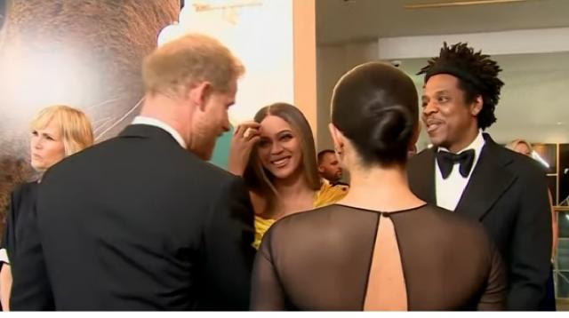 Queen B & Jay-Z Greet Meghan Markle & Prince Harry at 'UK' Lion King Premier. [Image source/TMZ YouTube video]