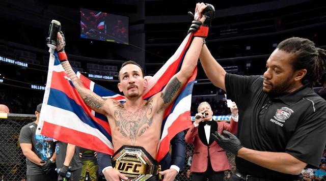 Holloway retuvo el campeonato de peso pluma. www.si.com