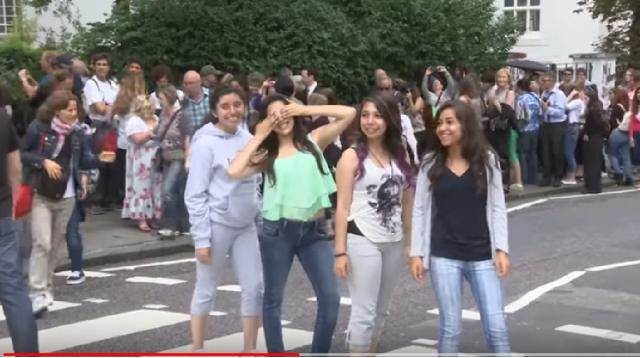 Beatles' Abbey Road crossing packed for 45th anniversary. [Image source/The Telegraph YouTube video]