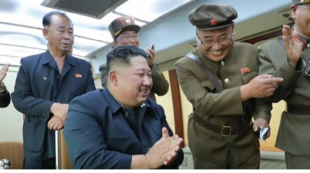 North Korea test-fires 2 missiles. [Image source/CBS Evening News YouTube video]