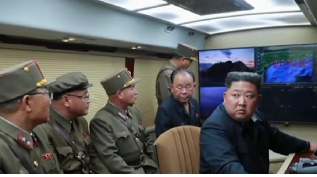 Trump downplays North Korea's latest missile tests. [Image source/CBS News YouTube video]