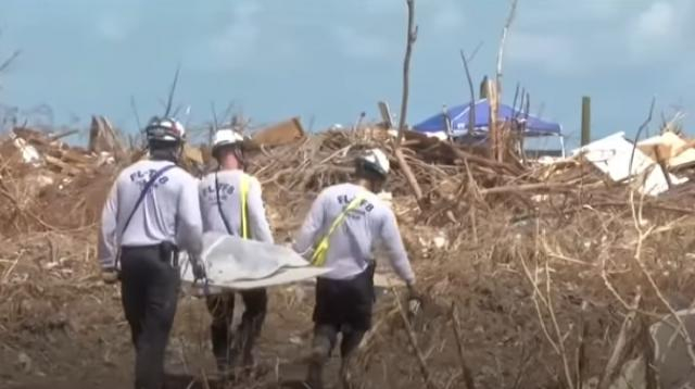 Hurricane Dorian: Search teams scour Bahamas wreckage for victims. [Image source/BBC News YouTube video]