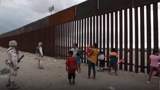 Seesaws cut through Mexico-U.S. border wall. [Image source/CGTN YouTube video]