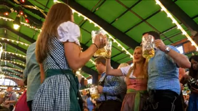 Revelers at Munich's Oktoberfest. [Image source- Rick Steve's Europe | YouTube video]